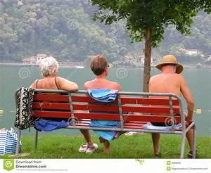 People Relaxing On Park Bench Stock Photo - Image: 2588050