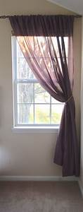 The Single Window With Two Sheer Curtain Panels On A