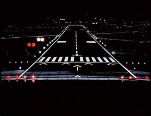 Airport Runway At Night Photograph by Lamyl Hammoudi