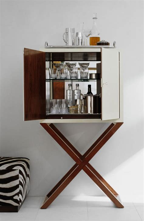 Cocktail Bar Furniture by A Chic Bar Cabinet Reveals The Makings Of Cocktail Hour