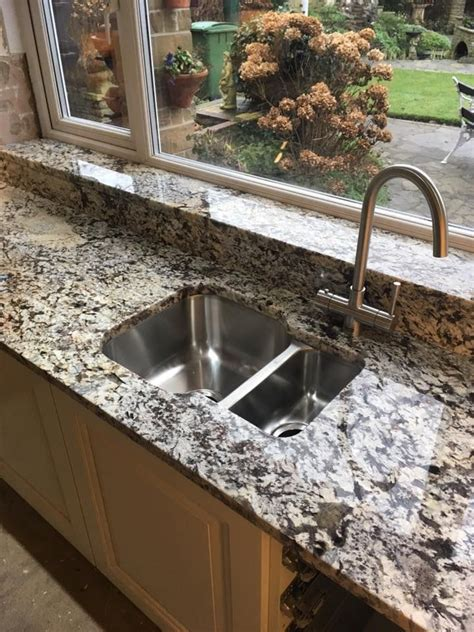 lennon gold granite worktop  undermount sink upstands  windowsill adam amies place