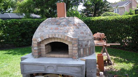 small rectangular table with pedestal base interior wood fired pizza oven designs modern sinks for