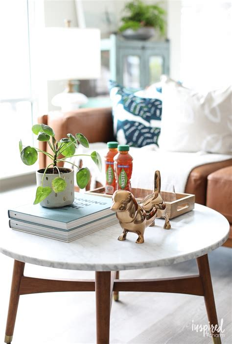 This decorating style works great with wooden tables and a calm, relaxed color palette. Simple Coffee Table Styling Ideas