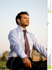 Young Indian Business Man Meditating Royalty-Free Stock ...