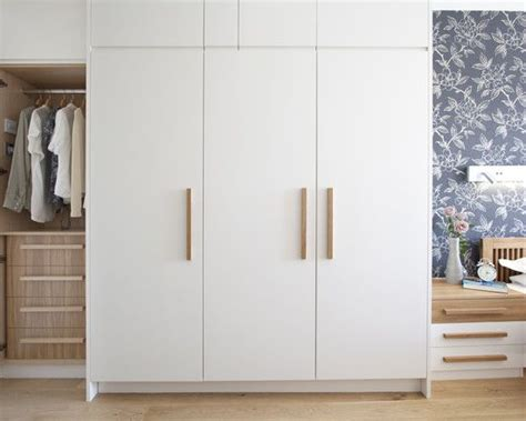 clean white wardrobe with wooden handles wardrobe