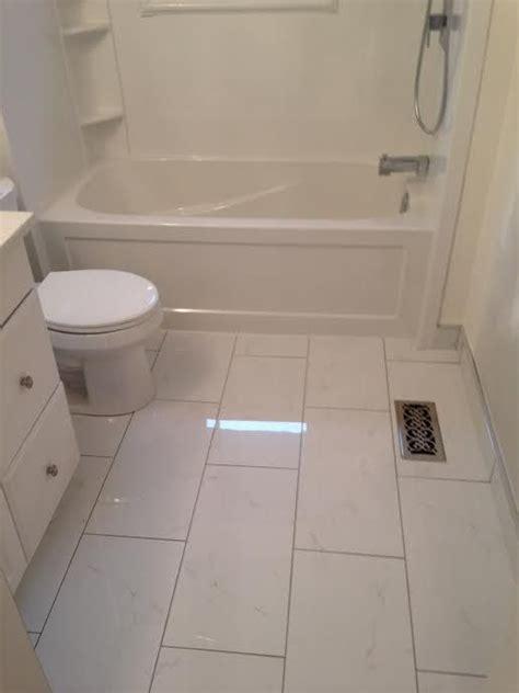12 x 24 ceramic tile for the floor white cabinet tub