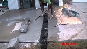 Downspout drain under concrete how to cut remove for How to cut a hole in concrete floor