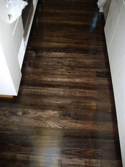chocolate brown stained floor beautiful  tiny home