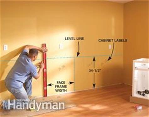 how to install base cabinets how to install kitchen cabinets family handyman