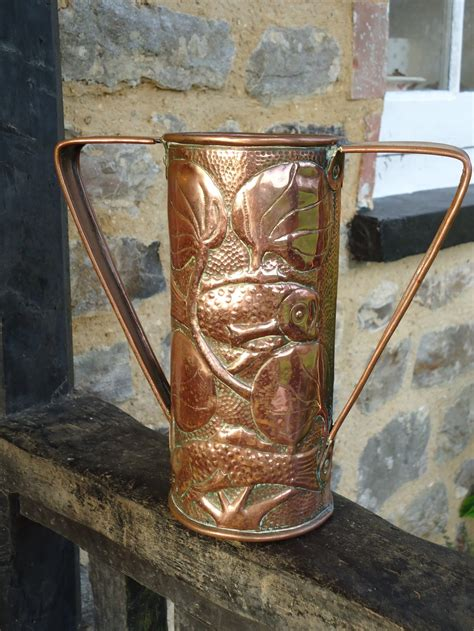 antiques atlas arts crafts copper vase  fish john