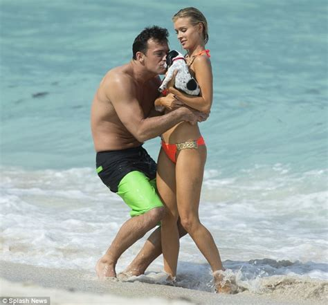 Joanna Krupa smothers her dog Darla with kisses as she carries her close to her heart   Daily