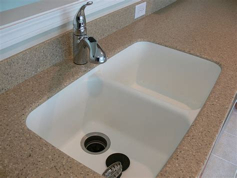 kitchen countertop with built in sink corian countertop integrated seamlessly with the kitchen s 9316