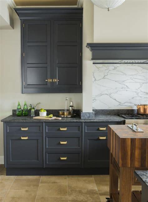 dark grey kitchen cabinetry satin brass hardware marble