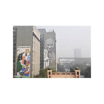 mural of Mahatma Gandhi being painted on the walls