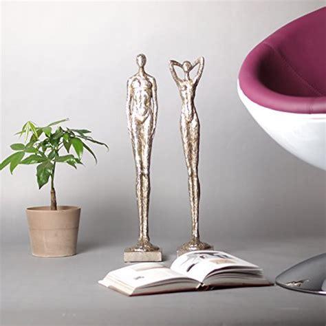 design skulptur set frau mann millenium oscar deko