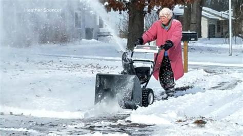 Photo Of An 82-year-old Woman Using Her Snow Blower In The