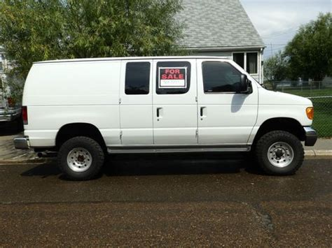 purchase   ford  econoline van quigley wd