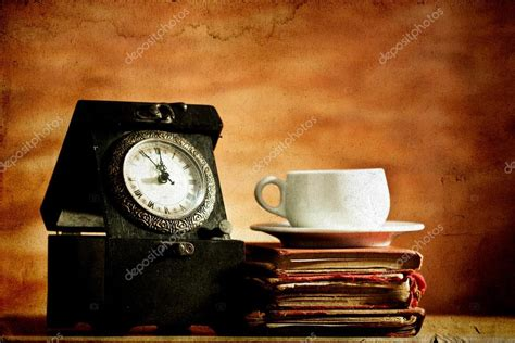 Try to get custom facebook banners now. Old clock, coffee and vintage books on grunge background ...
