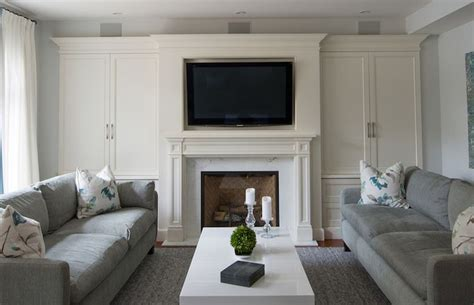 beautiful living room  creamy white built  cabinets
