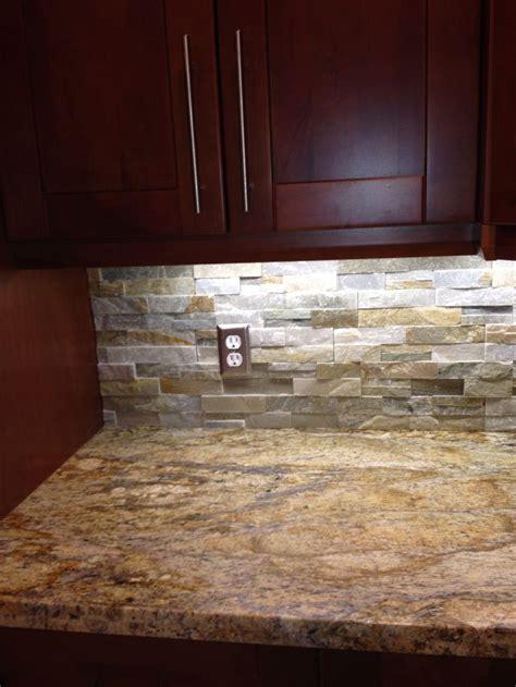 yellow river granite  quartz ledgestone backsplash