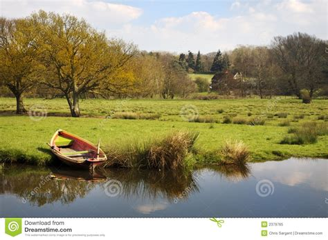 rowing boat  river bank royalty  stock photo image