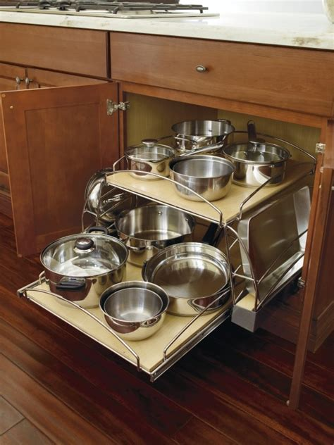 kitchen storage cabinets for pots and pans pots and pans organizer base cabinet by thomasville