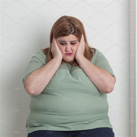 worried overweight woman high quality people images