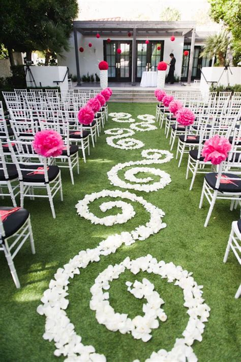 Wedding Ceremony With Flowers Down The Aisle