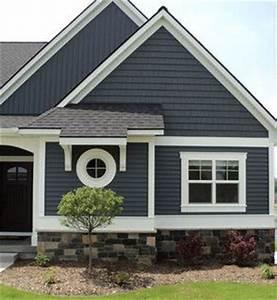 Dark blue/grey vinyl siding on a house with stone veneer ...