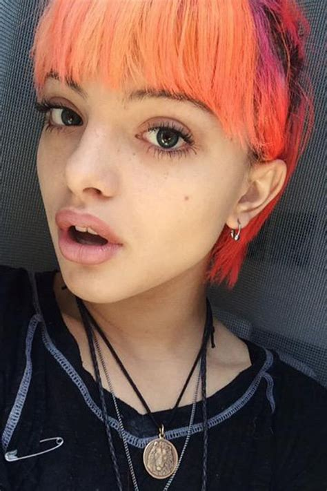 nia lovelis straight orange choppy bangs uneven color hairstyle steal  style