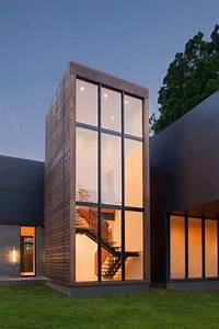 Modern Box House With Interior Glass Bridges