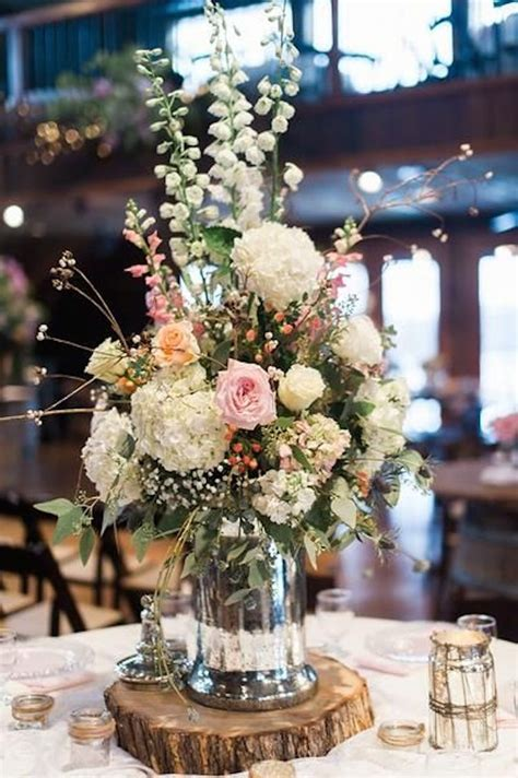 centerpieces table gorgeous floral centerpiece on a rustic wood slab onewed com