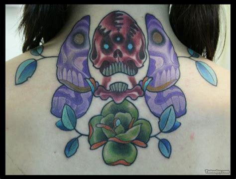 Upper Back Skull Butterfly Tattoo Design For Girls