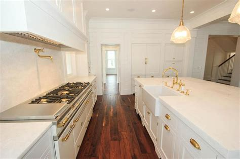 white kitchen  white honed marble counters
