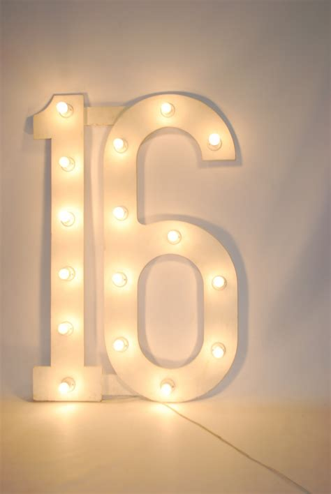 large number 16 with bulbs theme prop hire