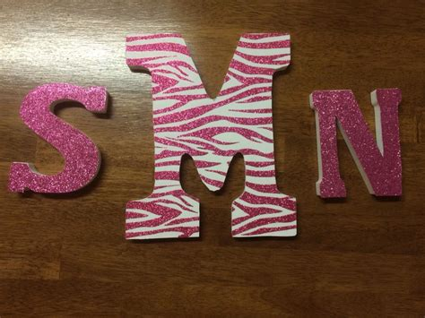cheap crafts michealshobby lobby wooden letters  scrapbook paper michaels pink glitter