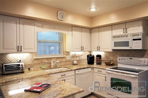 Creamy White Kitchen, color in counter give warmth, and