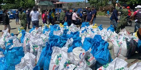 china adventists donate rice  underprivileged families