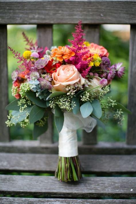 prettiest fall wedding bouquets  stand