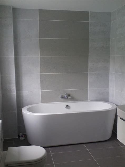 white and grey bathroom ideas awesome small space grey bathroom added oval white tub also grey wall tile in modern decors
