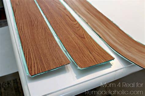 vinyl plank flooring peel and stick remodelaholic diy plank backsplash using peel and stick