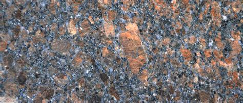 Coffee brown granite is available in both tiles and slabs and recommended for all. Coffee Brown Granite - Slabs, Worktops, Flooring & Wall Cladding | MKW Surfaces