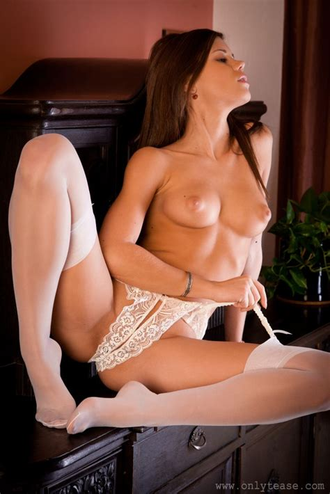 Little Caprice in white denim mini, strappy top & stockings at Only Tease