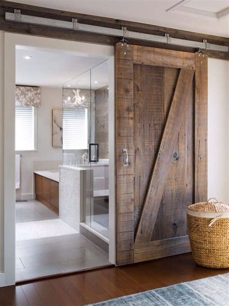 contemporary bathroom  rustic sliding wood door
