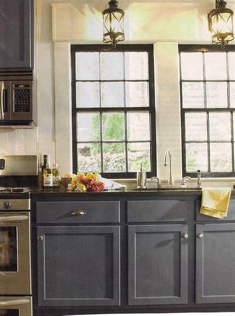 lanterns  greyblue cabinets black window frames