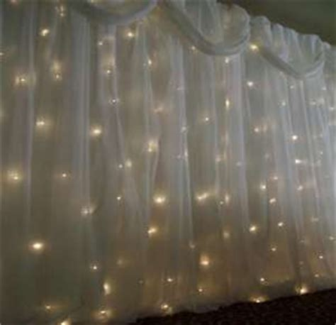 twinkle light curtains fabric and lights for hiding a not so great