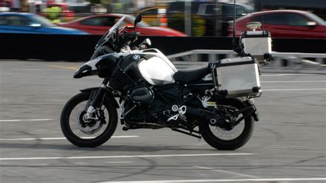 bmws riderless  driving motorcycle    spin