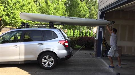 kayak roof rack hobie loading onto revolution
