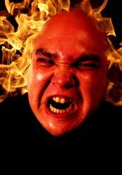 Angry man with flames stock photo