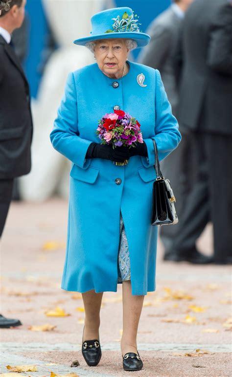 queen elizabeth visits poundbury supermarket  bright blue monochrome outfit instylecom